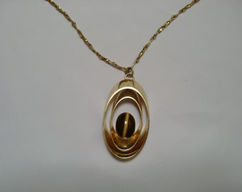 Vintage Pendant - Gold Tone Pendant with Cat Eye Looking Crystal In Center