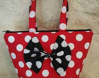 Small fabric tote bag, red with white polka dots and black polka dots. big bow tie. closure