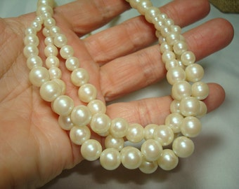 1992 Triple Strands of Ivory Colored Simulated Pearl Necklace.