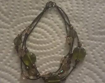 Vintage multi-strand chain bracelet with plastic beads