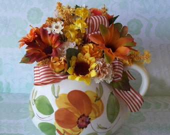 Colorful Floral Arrangement in a vintage hand painted ceramic pitcher