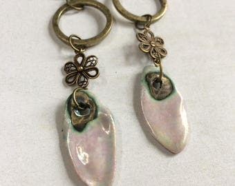 Artisan porcelain earrings. Pinky mother of pearl ceramic dangle earrings.Orchid and crackle gazes.