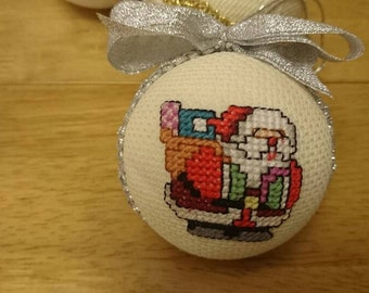Cross stitch Christmas bauble , ready to be hung on