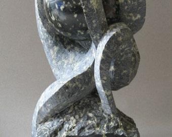"""Green serpentine sculpture. """"Torment"""""""