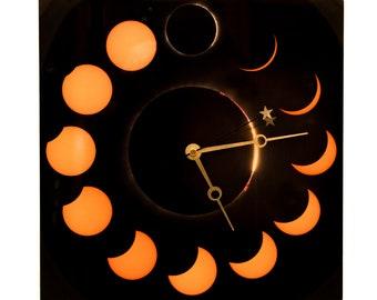 """12"""" x 12"""" Metal Solar Eclipse Wall Clock"""