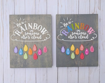Be a rainbow in someone else's cloud sign