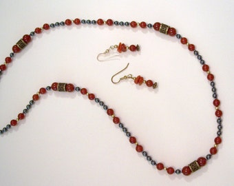 Carnelian and Hematite Southwest Style Necklace with Antique Brass Inscribed Barrel Beads by Carol Wilson of Je t'adorn