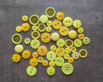 50 buttons round color shade yellow