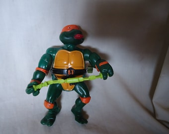 Vintage 1989 TMNT Teenage Mutant Ninja Turtles Michelangelo With Weapon Wacky Action Figure Toy by Mirage Studios, Playmate, collectable