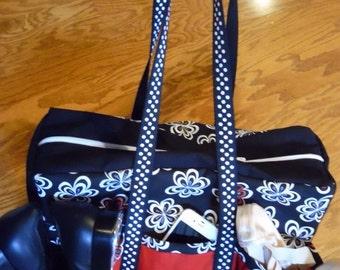 Black, white & red dance bag with outside pockets large enough to hold shoes or a water bottle.