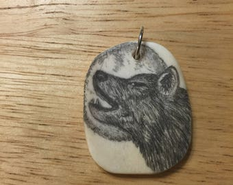 Howling wolf pendent In scrimshaw