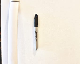 Attach your pen, marker, or pencil to any magnetic surface!