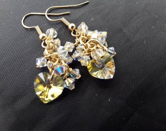Beautiful ab crystal cluster drop earings with swarovski hearts and bicones they are made with gold plated earwires.