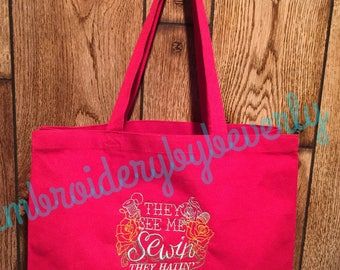 They see me sewin they hatin red canvas tote bag. Take it to your sewing, quilting, crafting classes.