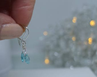 Dainty sterling silver earrings with faceted apatite briolettes.