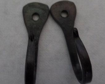 Tear drop horseshoe nail hooks. Hand forged horseshoe nail hooks. Decorative wall hooks.