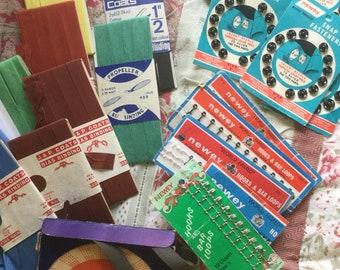 A job lot of vintage sewing  notions . Bias binding , seam binding , hooks & eyes