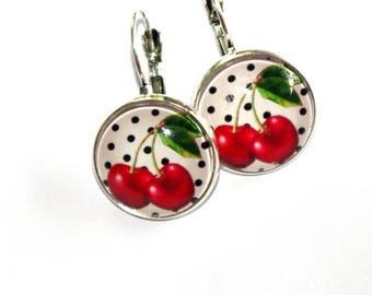 Earrings cherry polka dot background