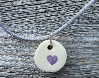 Necklace with small purple ceramic