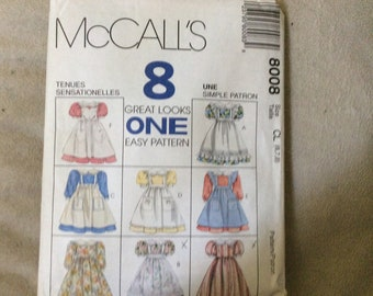 McCalls pattern #8008 child's dress and pinafore size 6,7,8