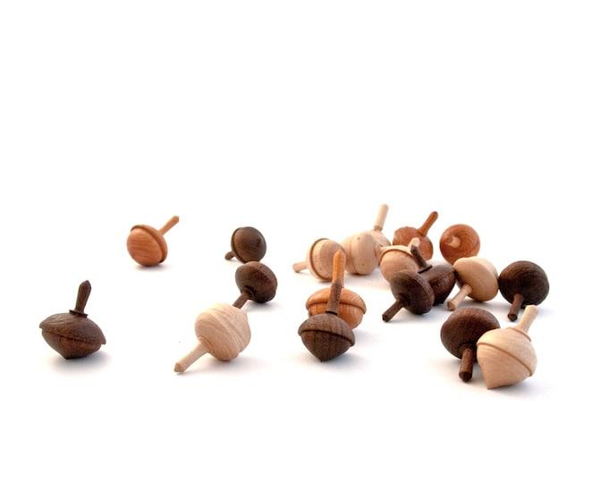 Set of three acorn spinning tops