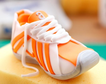 Running shoe cake topper, completely edible.  Handmade to order in any colour you choose.