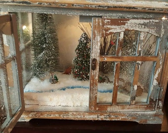 Snowy Eve of a wintery woodland  miniature scene set in a distressed wood terrarium with rabbits, a fox, squirrels, raccoons and stream