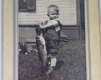 Art Deco mat frame boy photographed holding the catch of the day walleye