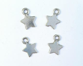 4 antique silver metal star charms