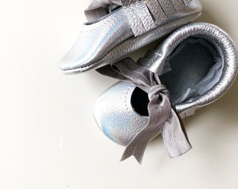 Silver iridescent 100% leather cow hide baby moccasin, Mary Jane style.