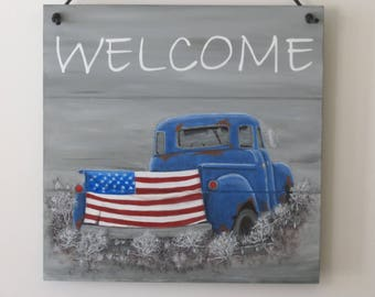 Hand painted Welcome plaque with rusty, old blue pickup truck and American flag