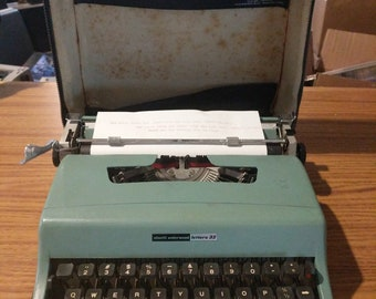 1968 light teal Olivetti Letter 32 ultra portable manual typewriter with carrying case