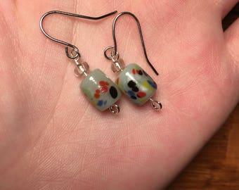 Polka dotted drop earrings