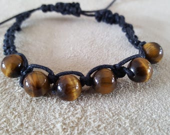 Bracelet braided / knotted with tiger eye beads