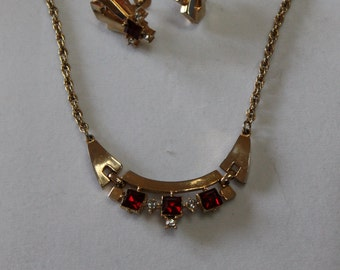 Vintage Coro 3-section gold lavalier necklace with red rhinestones and matching earrings