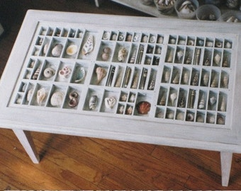 Coffee table custom made with a printer type box built in a collection table with a glass top that lifts out so you can display collections.