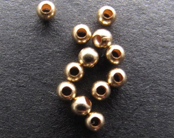 50 12k Gold Filled 2mm Round Spacer Beads, .9mm hole, shiny finish
