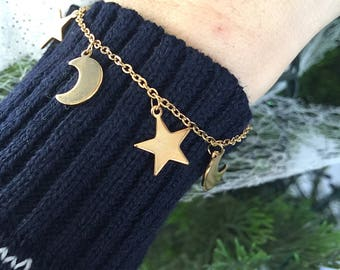 Gold bracelet with star and moon pendants