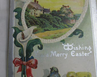 Post Card Wishing you a Merry Easter; yellow chick and blue bird with calla lilies and oval framed homes; 1911