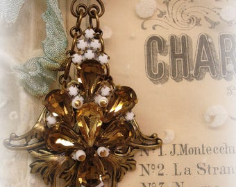 chandie candy one of a kind vintage assemblage chandie ornament chandelier crystals rhinestones vintage holy medal vertical bling