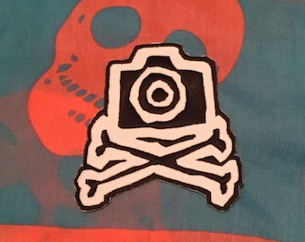 Camera and crossbones patch