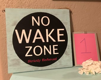 No wake zone / seas & greetings reversible sign