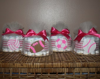 Small diaper cakes for a sports-themed baby shower, pink