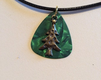 Brass coloured Xmas Tree on Green Guitar Plectrum Necklace.