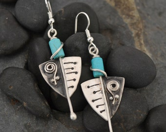 Sterling silver and turquoise howlite beads.
