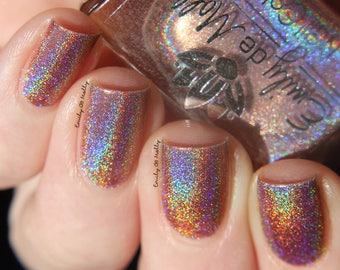 "Nail polish - ""Coming Around Again""  A light brown strong holo"