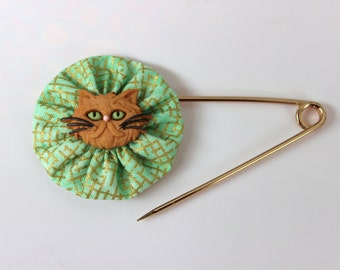 Pale Green and Gold Metallic Grid Print Fabric Yo Yo With Tan Cat Face Button Shawl Pin