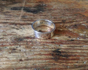 Heavy silver ring hammered surface