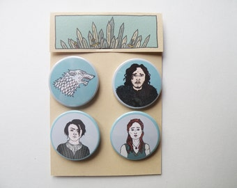 Game of Thrones pin badges, Jon Snow, Arya, Sansa Stark and their shield.