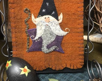 Gnarly Gnome is the name of this pattern, done in wool applique.